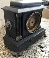62 - INTERESTING BLACK TABLE CLOCK