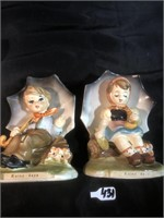 "2 ""Rainy days "" boy and girl figurines. Made in"