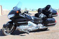 2002 Honda GL1800 Goldwing, w/reverse, saddle bags, radio, trl hitch, back compartment, exc cond, 70,557 miles, has title.  NOTE: This item will be sold at live auction, however absentee bids can be placed if you are unable to attend the auction. More details, video & pictures can be viewed by clicking the catalog tab and view Lot #5.  Video available!