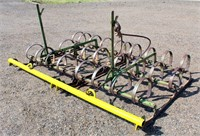 John Deere Springtooth, 2-section, pull-type.  NOTE: This item will be sold at live auction, however absentee bids can be placed if you are unable to attend the auction. More details & pictures can be viewed by clicking the catalog tab and view Lot #13.