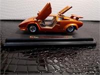 Orange Burago 1988 Lamborghini Countach 5000
