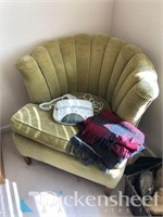 Green cushioned chair along with throw
