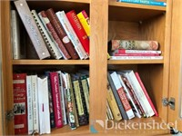 Lot of cookbooks, tv trays,