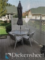 Circular patio table with chairs and