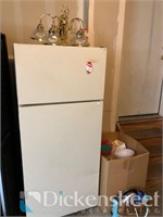 Refrigerator/freezer in garage along