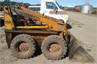 Case 1830 skid steer with 1 yard bucket at