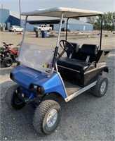 Gas powered club car with a lift and bigger tires