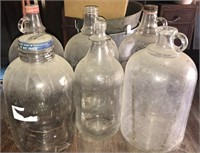 6 glass gallon jugs, one with Coca-Cola cap