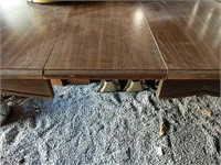 Wood dining table with Formica top and 1 leaf