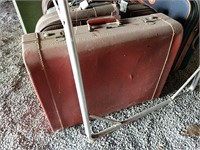 Large assortment of vintage suitcases