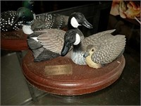 Waterfowl figurines on wood bases