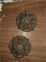 Ornate door hinges and brass rosettes