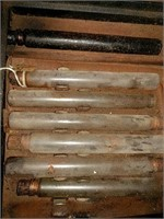 Corked glass tubes in broken case