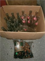 Box of bottles and bag of caps