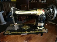 Deluxe sewing machine and cabinet