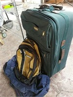 Green luggage and duffel