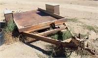 Utility Flatbed TL, single-axle, bumper-pull, tilt bed, 6' x 10'