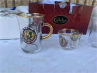 Assorted gold rim shot and tea cups