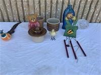 Three ceramic pots, two birds, one teddy bear,