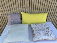 Assorted pillows and couch cushions