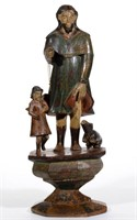 """Fine 19th-century carved and painted Santos figural group, 23"""" HOA."""