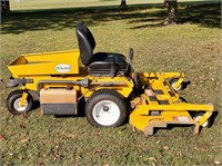 Garage kept Walker zero turn lawn mower. Tilt bed.