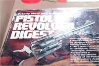 Brown leather holster, pistol digest & pistol grip
