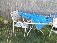 patio chairs & table w/ umbrella needs repair