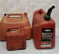 3 assorted plastic gas cans