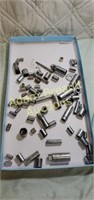 64 assorted sockets and extensions