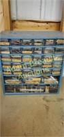 34 drawer storage organizer full of clock making