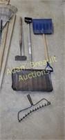 Assorted hand tools that brooms, shovels, rakes,