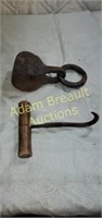 Vintage Pig hook and cast-iron iron coupling with