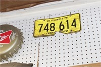Beer signs, dart board & license plates