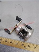 3 fishing reels - Abu, Zebco, Bass Pro Shop