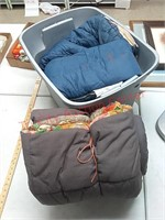 Two sleeping bags and plastic tote with lid