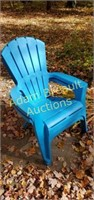 2 blue plastic molded stackable patio chairs,