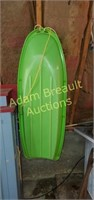 Lime green plastic snow sled