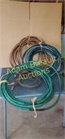 3 assorted garden hoses