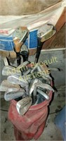 Vintage vinyl golf bag and assorted clubs
