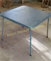 Blue vinyl metal frame card table