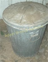 Vintage galvanized trash can with lid
