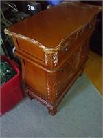 Nice carved 3 drawer ended table. Bottom drawer