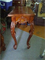 Nice carved entry way table. Needs repairs on