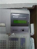 Sharp electronic cash register with keys.