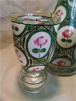 Hand blown and hand painted glasses and vase. One