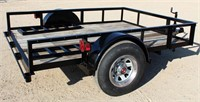 1988 Big Tex Flatbed, bumper-pull, single-axle, 6' x 10', ramps, exc cond - This item will be sold at LIVE auction with ABSENTEE BIDDING available. More info, pics and video can be found in the catalog (see lot 5014).
