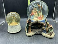 2 religious snow globes - both musical