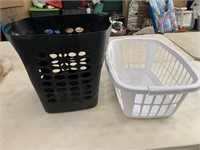 2 laundry baskets - handles are cracked on white