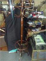 Nice wooden coat rack. Needs tightened. 6ft tall.